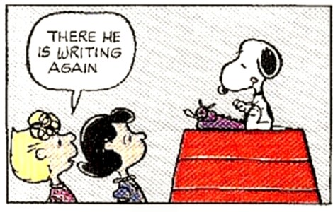 snoopy writing at typewriter