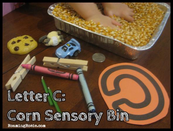 C is for Corn Sensory Bin {Alphabet Activities at RoamingRosie.com}