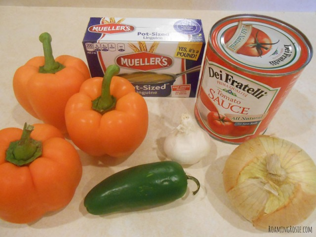 Spicy Spaghetti Worms in Pepper Jack O Lanterns Halloween Recipe at RoamingRosie.com