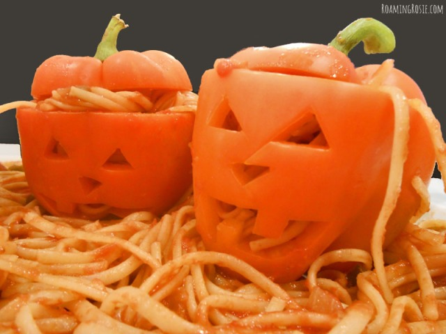 Spicy Spaghetti Worms in Pepper Jack O Lanterns Halloween Recipe at RoamingRosie.com